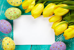 Easter eggs, tulips and card Stock Photos