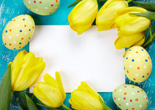 Easter eggs, tulips and card Royalty Free Stock Photo