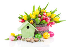 Easter eggs with tulips flowers and birdhouse Royalty Free Stock Photo