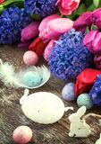 Easter eggs with tulips and hyacinth Royalty Free Stock Images