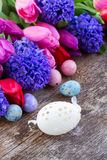 Easter eggs with tulips and hyacinth Stock Photo