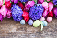 Easter eggs with tulips and hyacinth Royalty Free Stock Photo