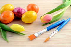 Easter eggs with tulips and paintbrush Royalty Free Stock Photography