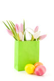 Easter eggs and tulips in paper bag Stock Images