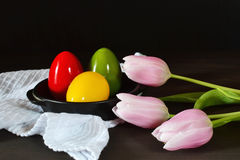 Easter eggs and tulips Stock Photography