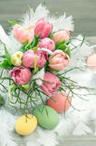 Easter eggs and tulips with water drops Stock Photos
