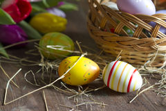 Easter eggs and tulips on wooden board Stock Photography