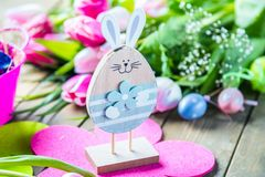 Easter eggs and tulips on wooden planks with German text Happy Easter. stock images