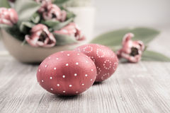 Easter Eggs and tulips on wooden table Stock Image