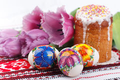 Easter eggs, tulups and cake Royalty Free Stock Images