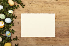 Easter eggs and twigs, blank card on wood Royalty Free Stock Photo