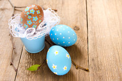 Easter eggs. And twigs on old wooden background, close up, horizontal, copy spase Stock Photography