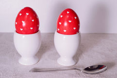 Easter eggs. Two colored eggs in the small cup Royalty Free Stock Image