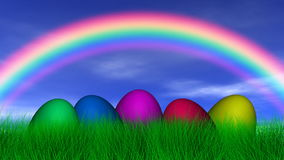 Easter Eggs Under a Rainbow Royalty Free Stock Photos