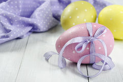 Easter eggs with violet ribbon Royalty Free Stock Image