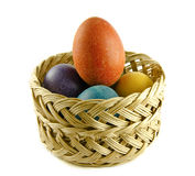 Easter eggs in a wattled basket Royalty Free Stock Photography
