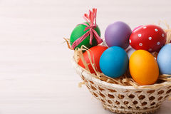 Easter eggs in a weaved basket Royalty Free Stock Images