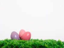 Easter eggs on white. Easter eggs on green grass Stock Photos