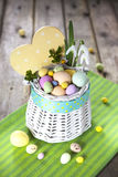 Easter eggs in the white basket Royalty Free Stock Photos
