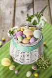 Easter eggs in the white basket Stock Images