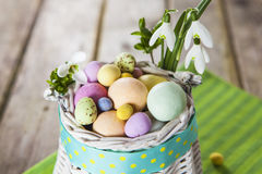 Easter eggs in the white basket Royalty Free Stock Images