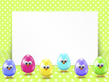 Easter eggs and white blank over dotted background Royalty Free Stock Photography