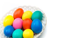 Easter eggs in white bowl stock photography