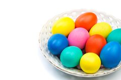 Easter eggs in white bowl stock photos