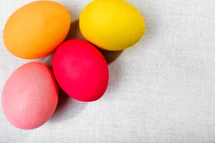 Easter eggs on the white cloth background Stock Photo