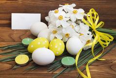 Easter eggs and white daffodils Stock Images