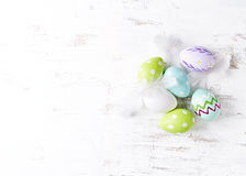 Easter eggs with white feathers. From above royalty free stock photography
