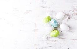 Easter eggs with white feathers Stock Photo