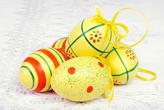 Easter eggs on white lace Royalty Free Stock Image