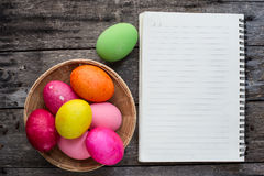 Easter eggs and white notebook on grunge Stock Images