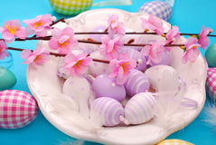Easter eggs in white plate Stock Photos