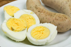 Easter eggs and white sausages Stock Photos