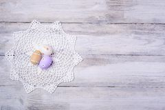 Easter eggs with white serviette on wooden background. Stock Photography