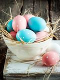Easter eggs in a white shabby bowl Royalty Free Stock Photos