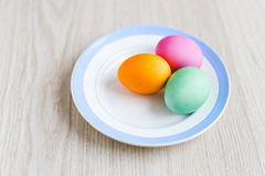 Easter eggs on a white table in the plate Royalty Free Stock Photography