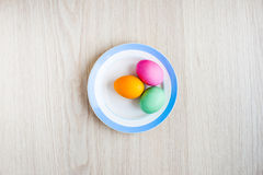 Easter eggs on a white table in the plate Royalty Free Stock Image