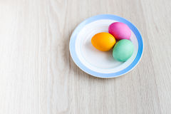 Easter eggs on a white table in the plate Stock Photos