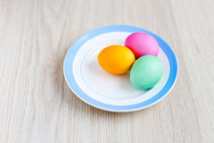Easter eggs on a white table in the plate Royalty Free Stock Photo