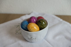 Easter eggs on white tablecloth Stock Photos