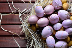 Easter eggs in a white wire basket Royalty Free Stock Photos