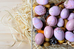Easter eggs in a white wire basket Royalty Free Stock Photo