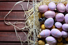 Easter eggs in a white wire basket Royalty Free Stock Photography
