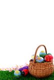 Easter eggs in wicker basket. Hand painted beautiful  colorful  easter eggs in wicker basket on fresh green grass Royalty Free Stock Photography