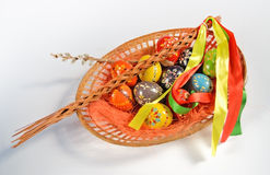 Easter eggs in wicker basket Stock Image