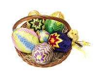 Easter eggs in wicker basket Royalty Free Stock Photo