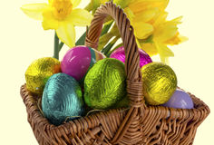 Easter eggs in a wicker basket. Stock Photos